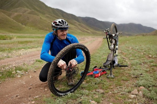 repair mountain bike on trail